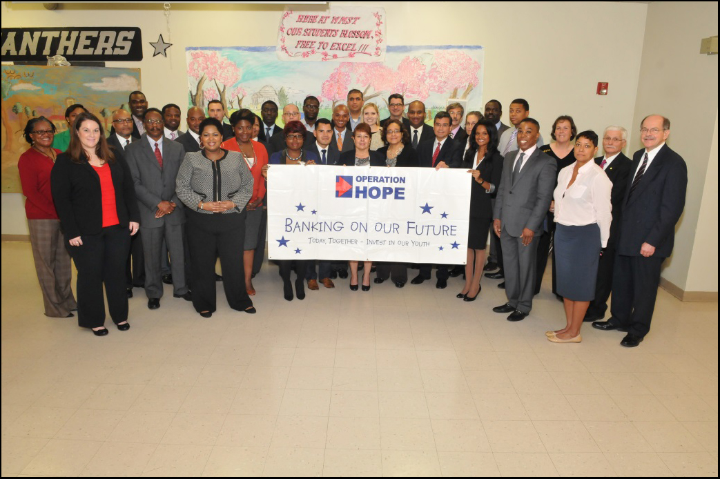 Operation HOPE gathers volunteers from various federal agencies to support teaching students financial literacy principles at the Banking On Our Future event.