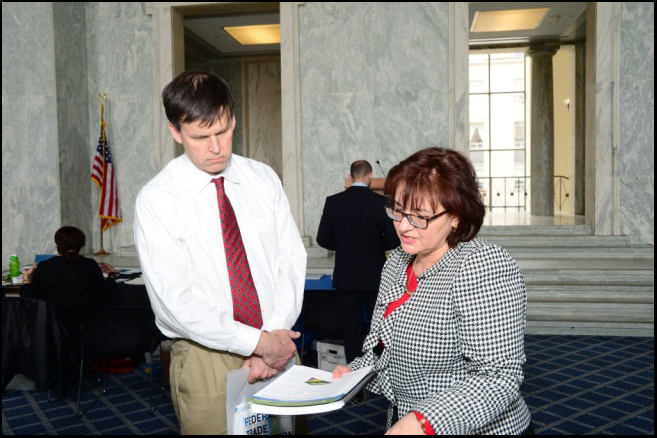 "Karen Bellesi, Community Development Manager, offers the Consumer Advisory ""Gift Cards: OCC Provides Tips to Consumers"" to a National Consumer Protection Week attendee."